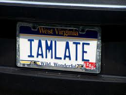 "A humorous vanity plat that reads ""I AM LATE"""