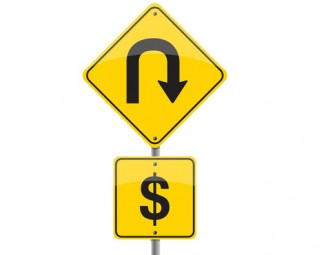 A road sign depicting a u turn and a dollar sign