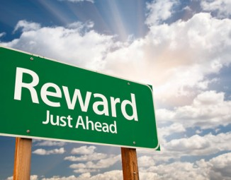 "A road sign that reads: ""Reward Just Ahead"""