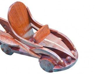 A toy car made out of wood