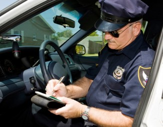 Police officer writing a traffic ticket