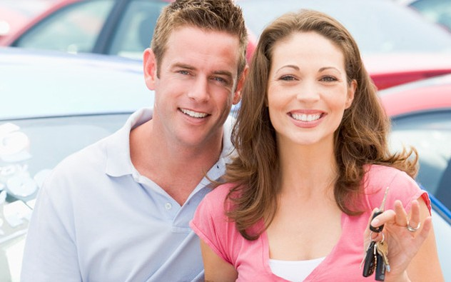 Couple Buying New Cars