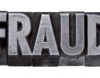 typewriter letters spelling the word fraud