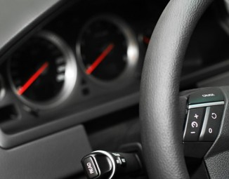 A close up of the cruise control button