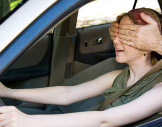 Teen driving blind folded