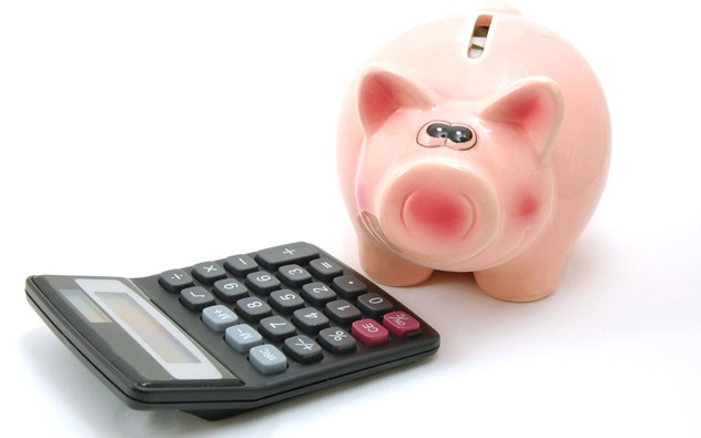 A ceramic piggy bank and a calculator